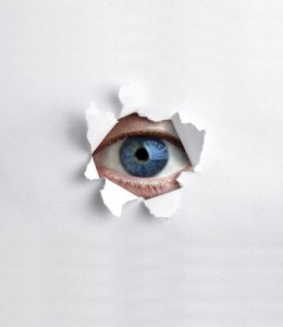 Looking through a hole in white paper © Brian Jackson - Fotolia