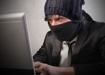 business hacker ninja security suit – (c) olly shutterstock
