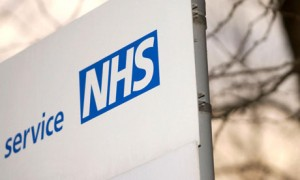 The NHS logo on a sign